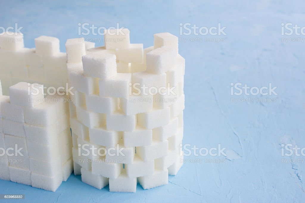 Sugar castle built out of sugar cubes, sugar tower, walls stock photo