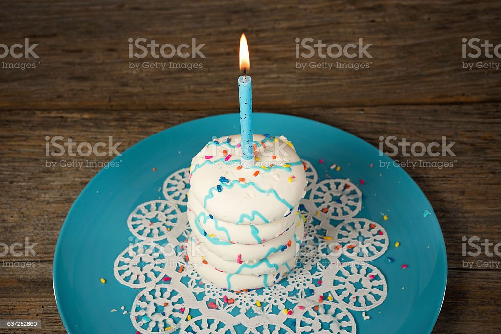 sugar cookie with birthday candle stock photo