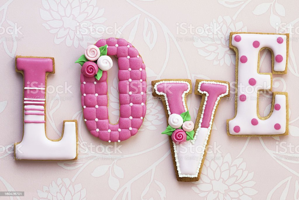 Sugar cookies spelling out LOVE stock photo