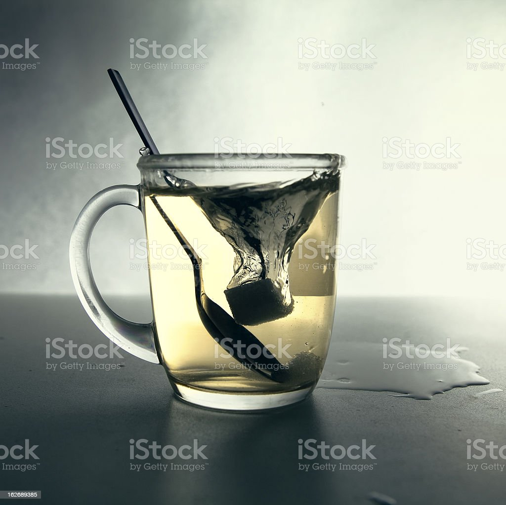 Sugar cube falling in water royalty-free stock photo