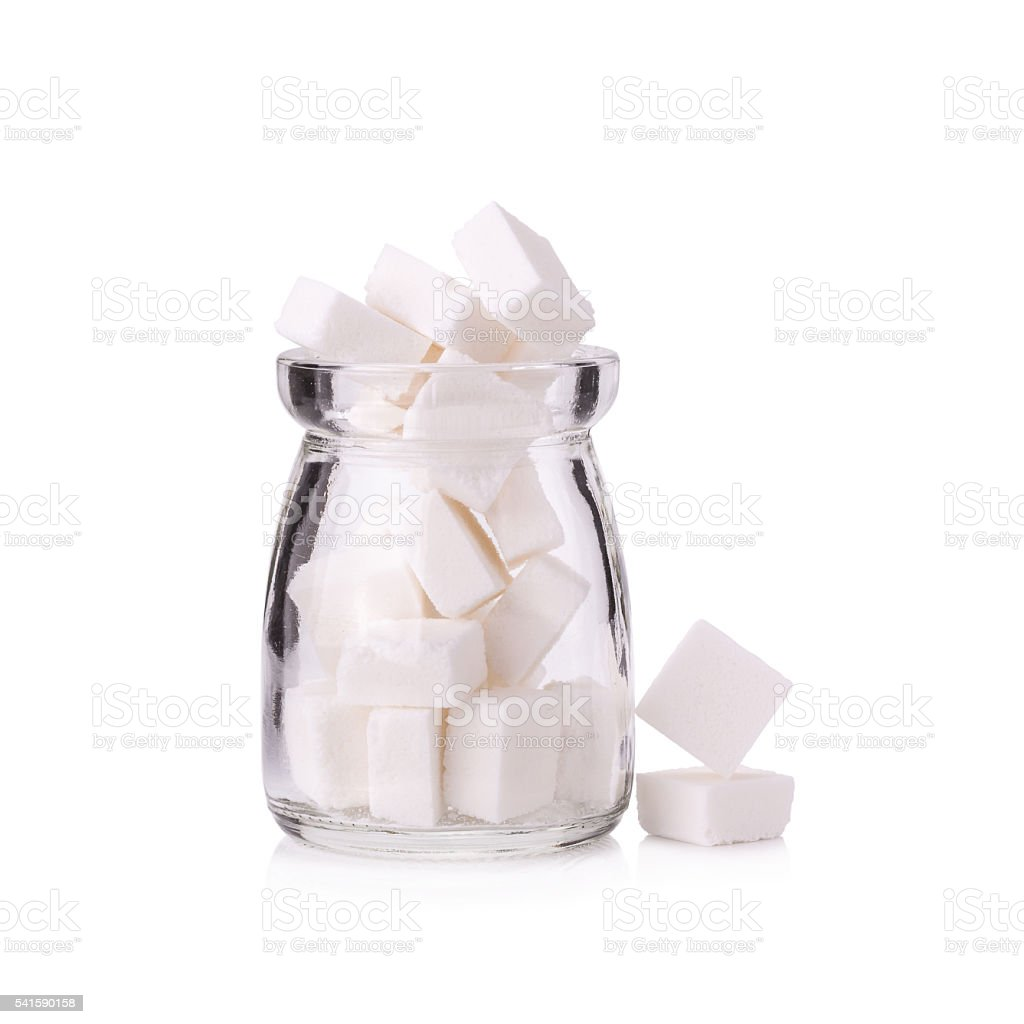 Sugar cubes in a glass bottle stock photo