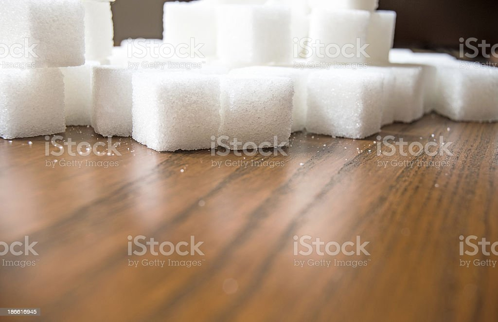 Sugar cubes on wooden table royalty-free stock photo