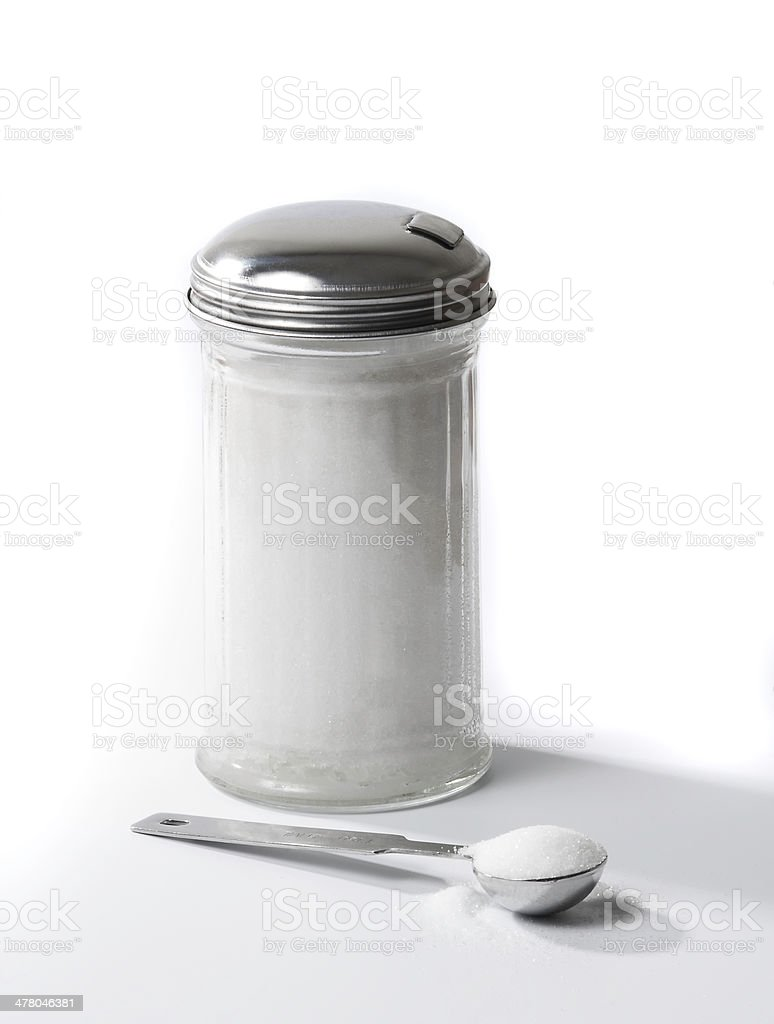 Sugar Dispenser and Tablespoon stock photo