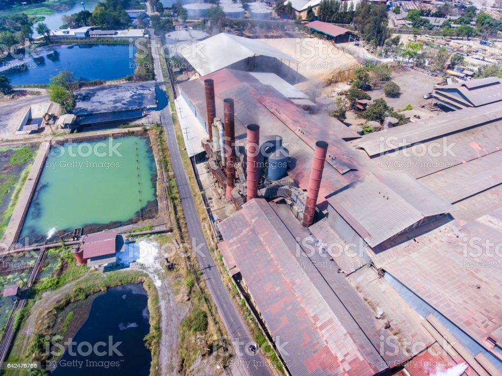 Sugar factory and smoking chimneys stock photo