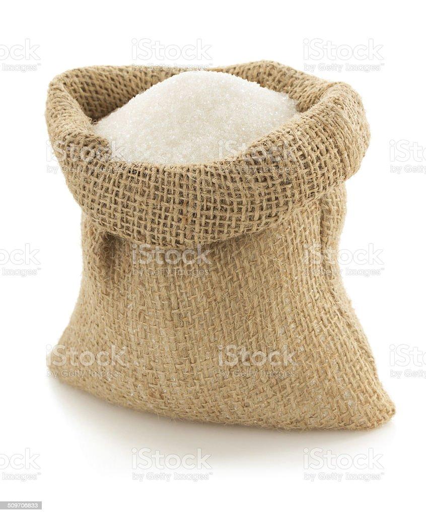 sugar granules in bag on white stock photo