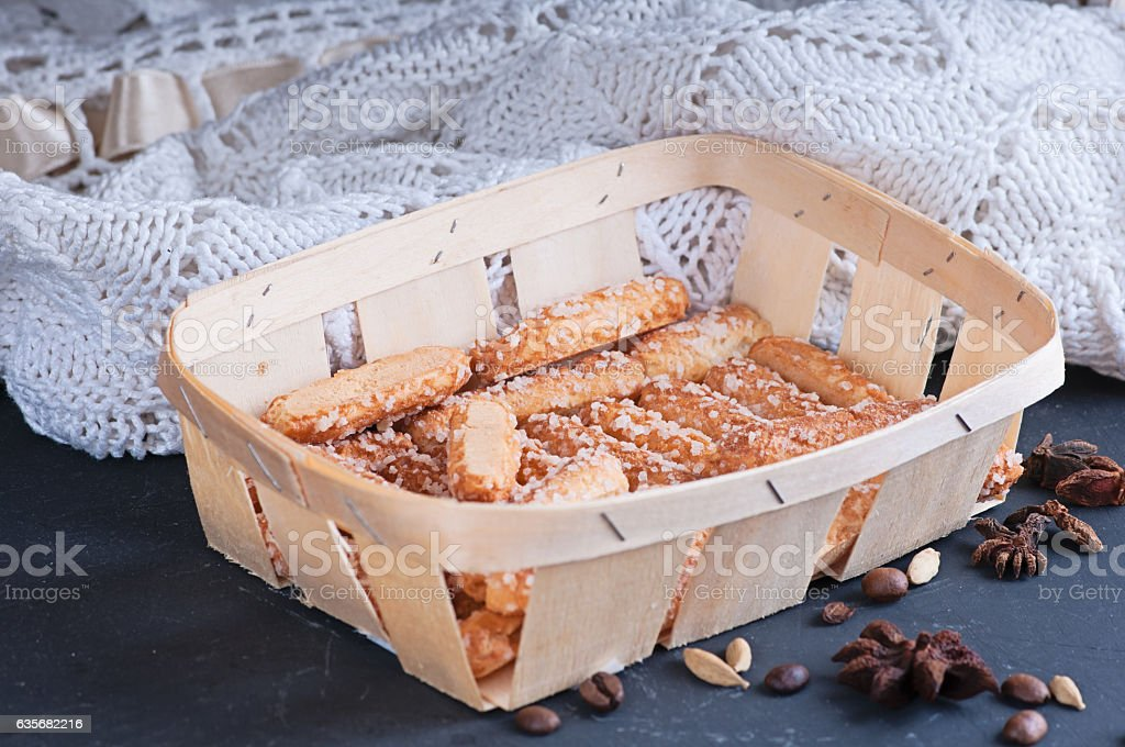 sugar homemade biscuits piled in a wicker basket stock photo