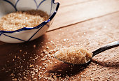 Sugar in a stainless spoon still life tone