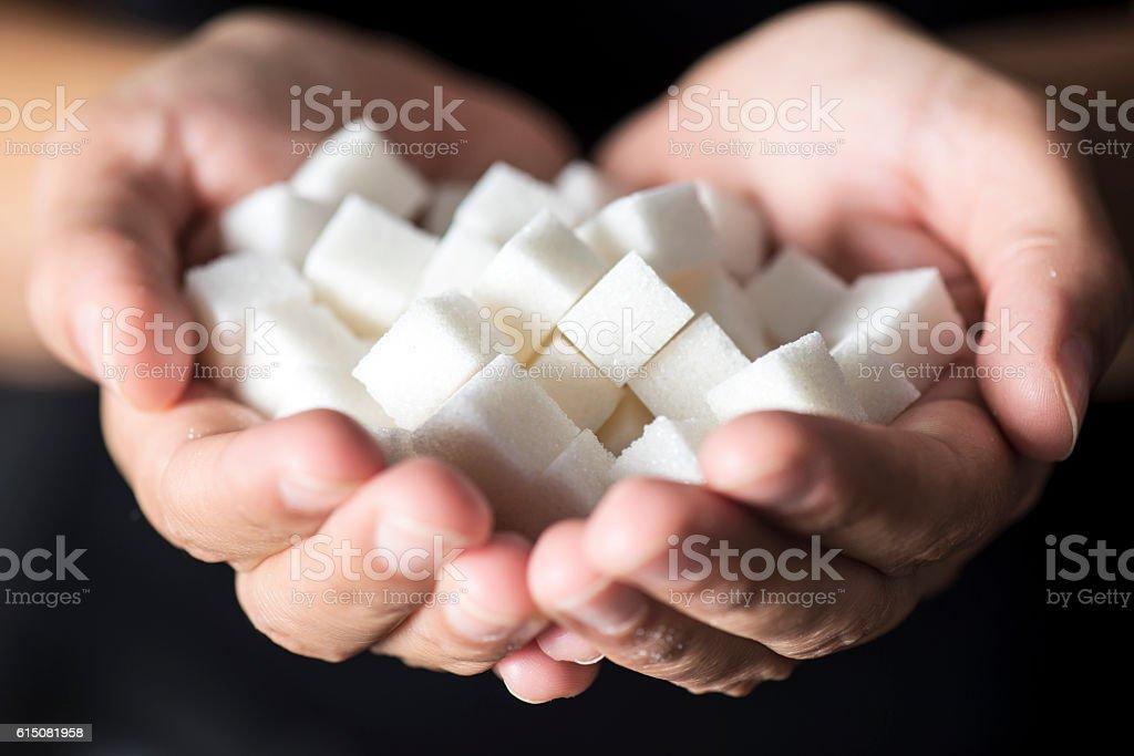 Sugar in Hands stock photo