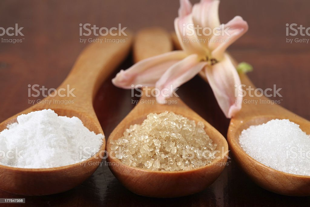 Sugar in wooden spoons royalty-free stock photo