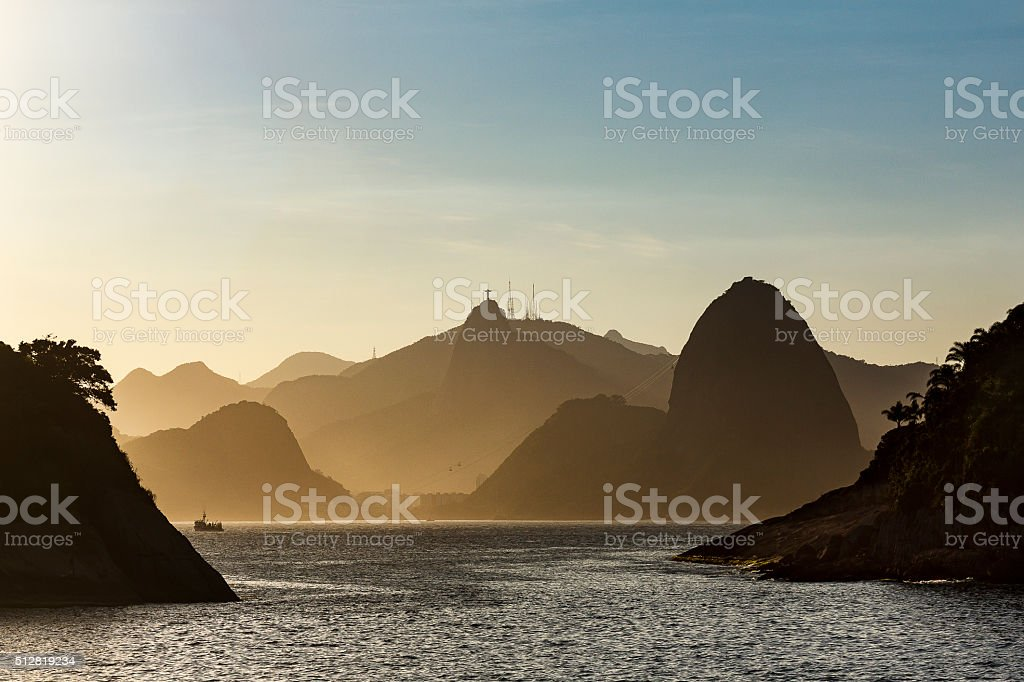 Sugar Loaf and Christ the Redeemer Statue by Sunset stock photo