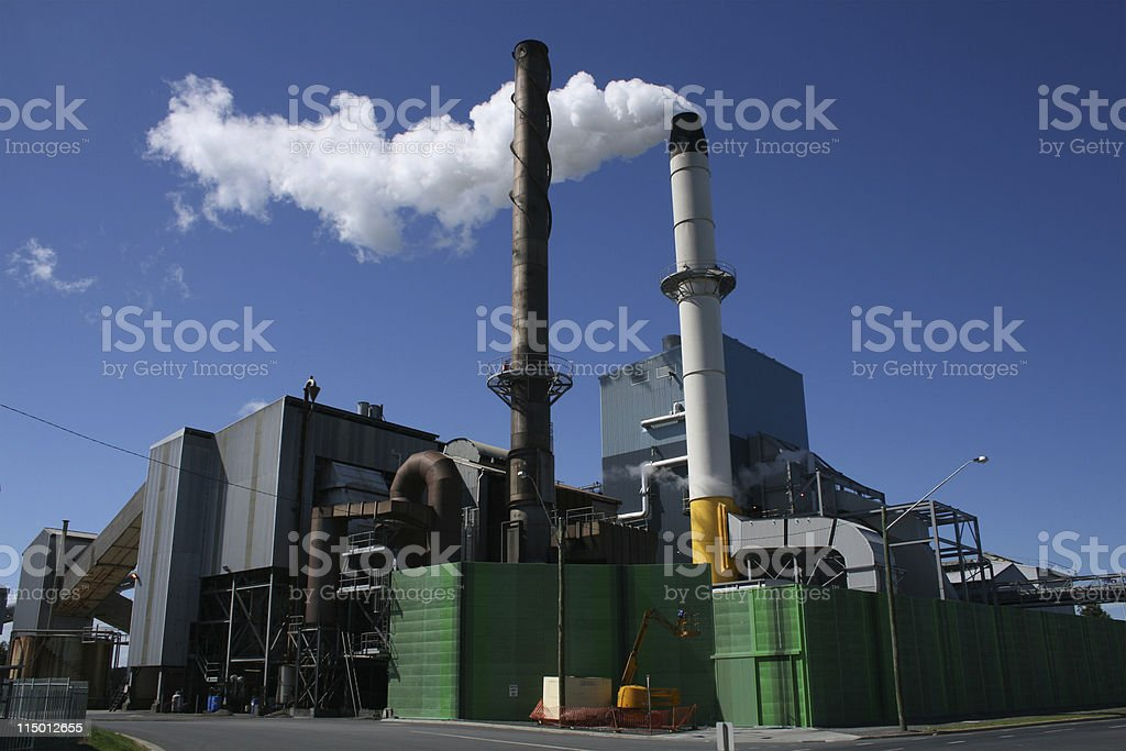 A sugar mill in front of a blue sky stock photo