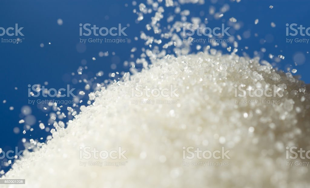 sugar on a blue background stock photo