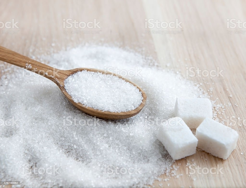 Sugar on wooden table. Selective focus stock photo