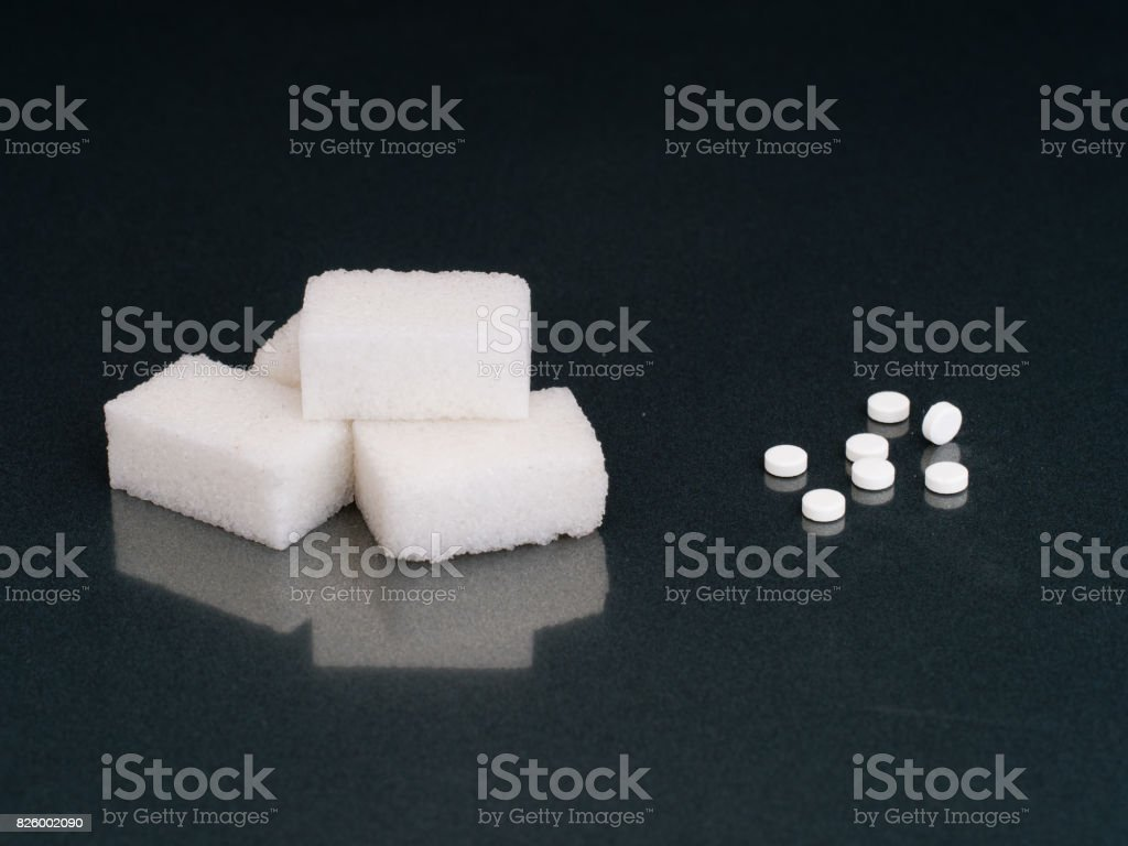 Sugar or artificial sweetener. The choice. stock photo