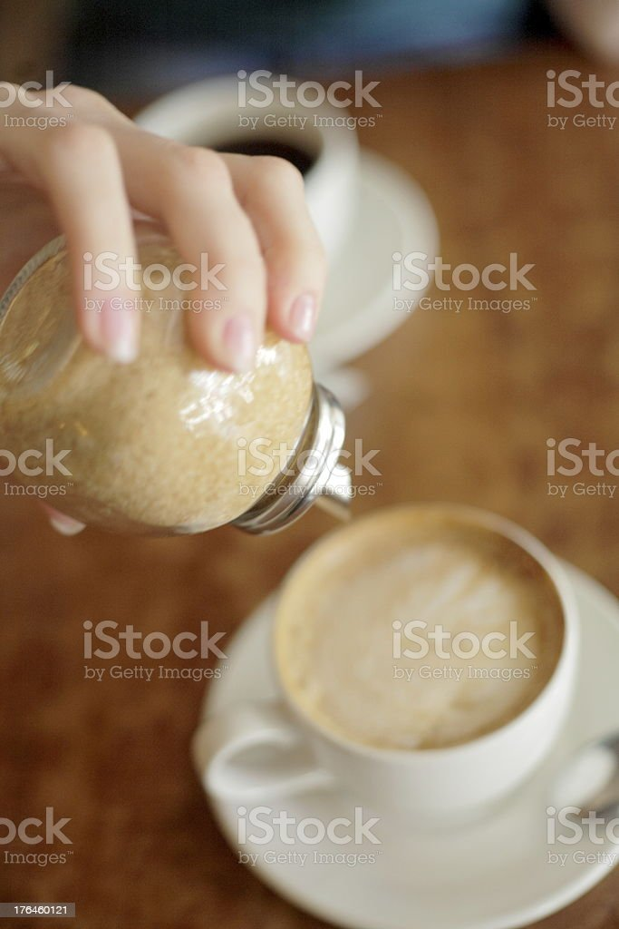 sugar pouring into a cup of tea royalty-free stock photo