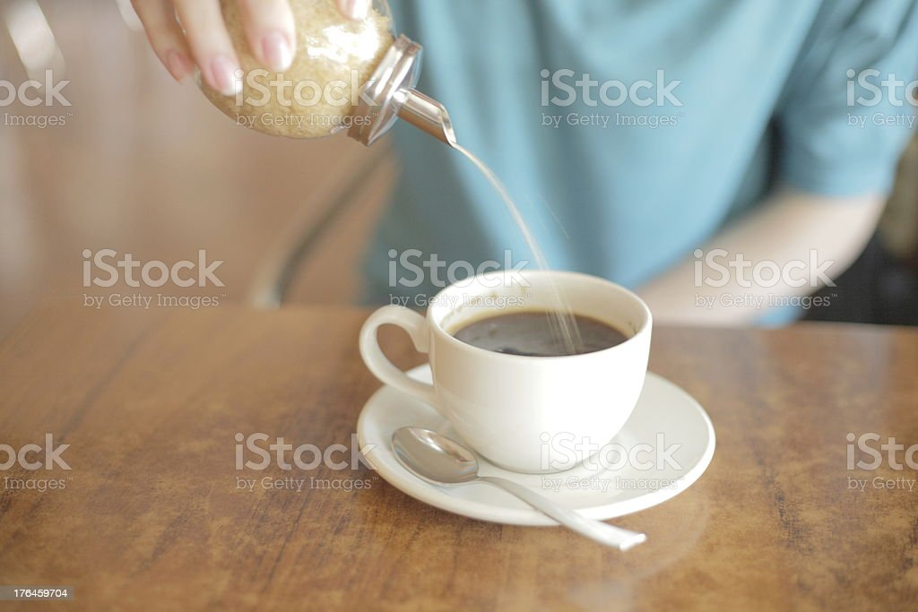 Sugar pouring into coffee royalty-free stock photo