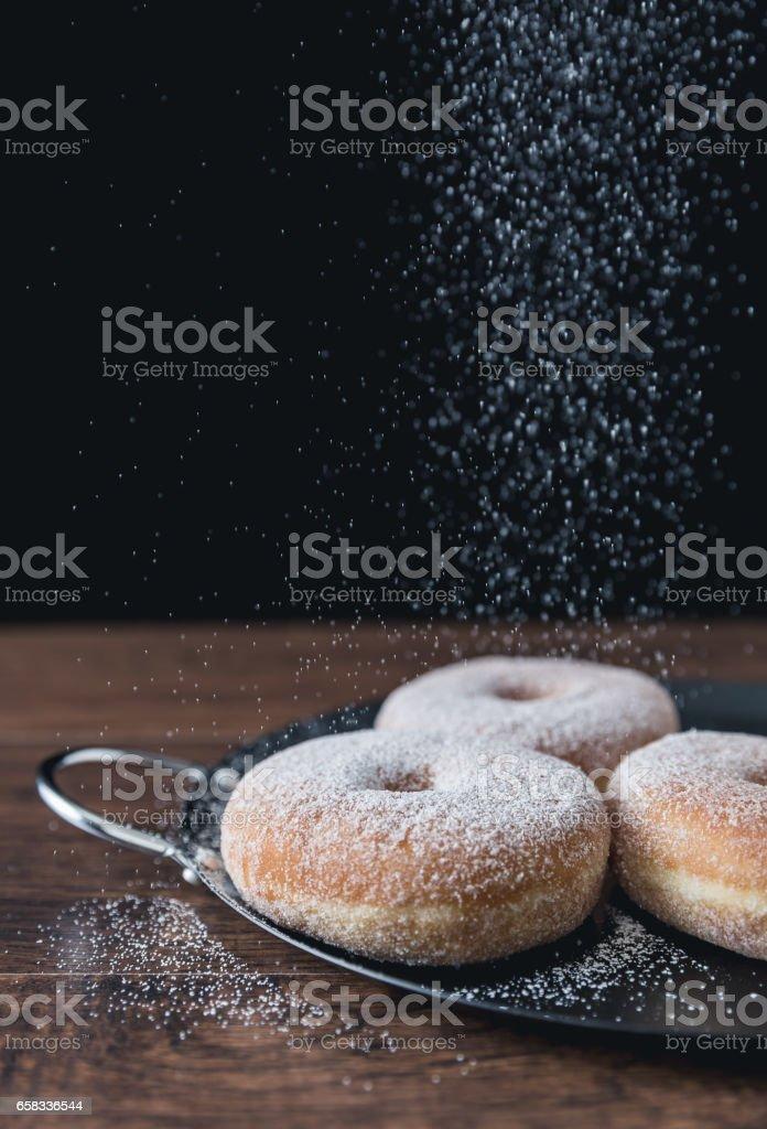 Sugar powdered donuts stock photo