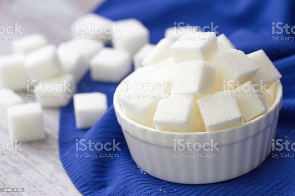 Sugar refined in white bowl stock photo
