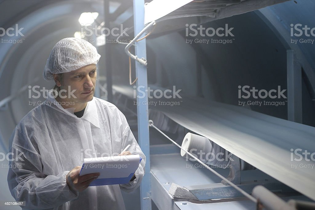 Sugar Refinery - Quality Control Inspector stock photo