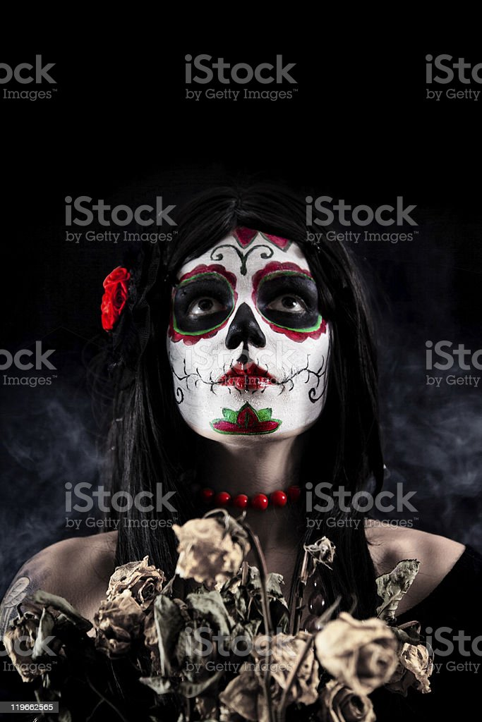 Sugar skull girl with dead roses royalty-free stock photo