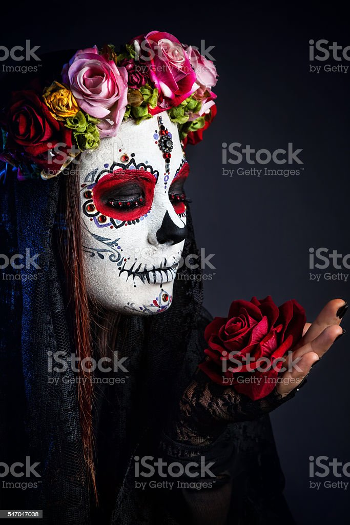 Sugar skull makeup girl with rose stock photo