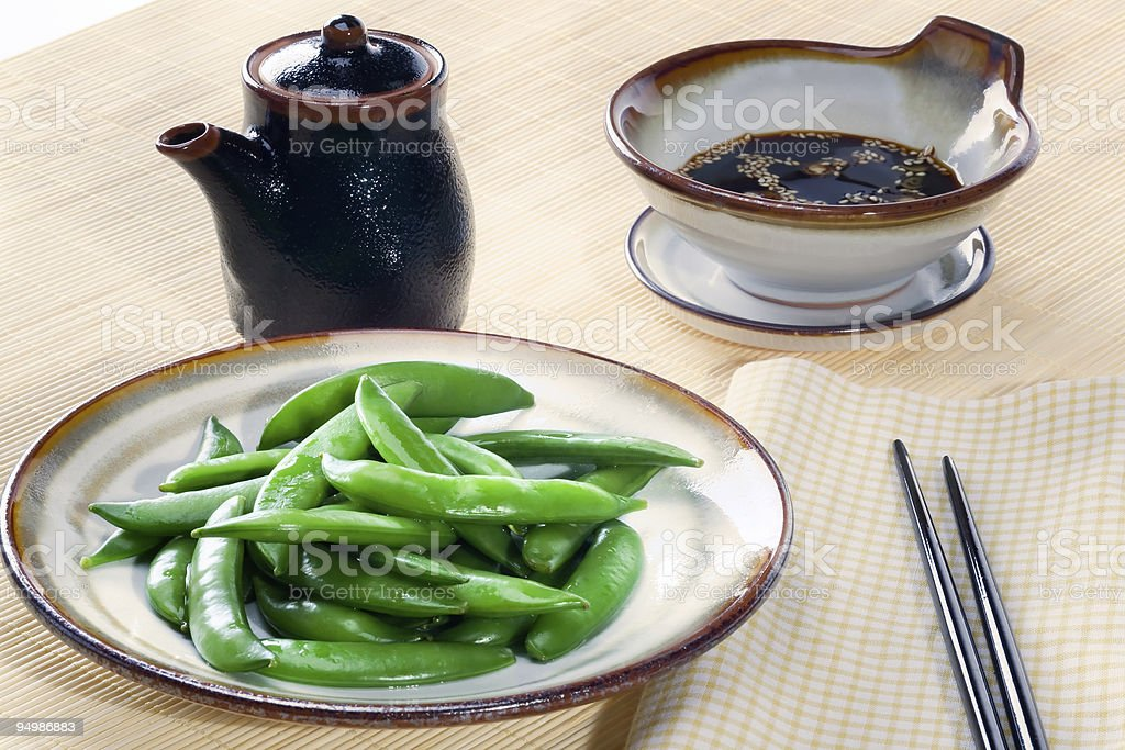 Sugar snap peas with dipping sauce royalty-free stock photo