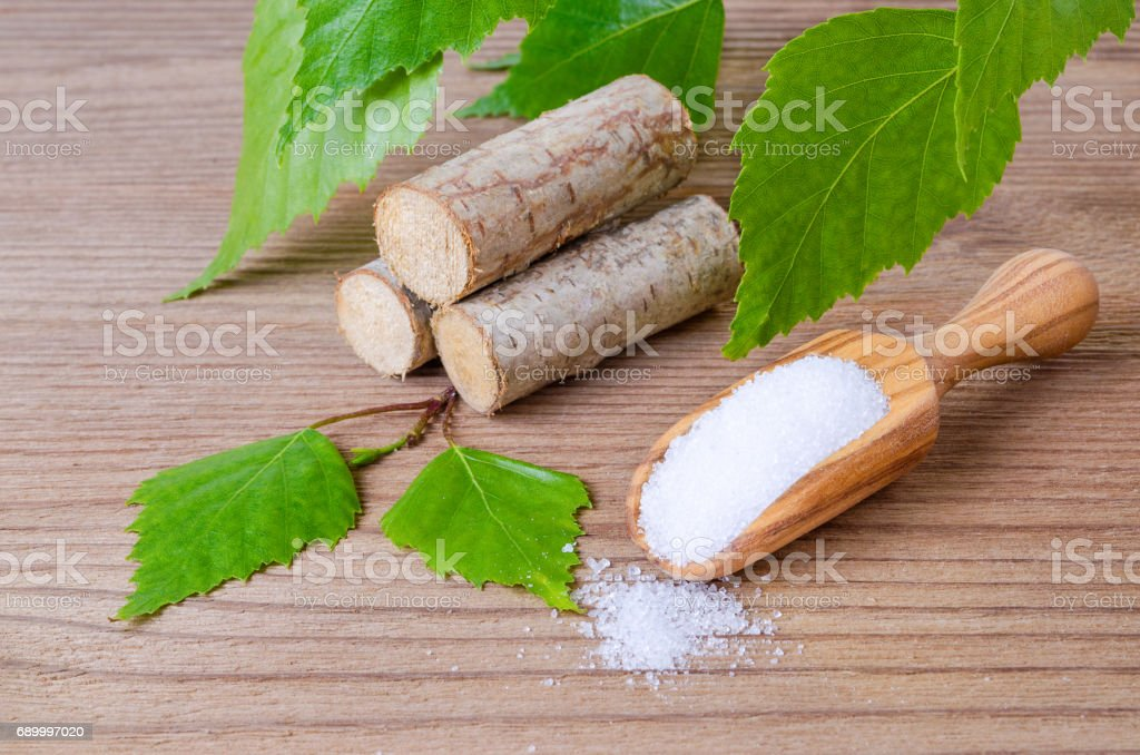 sugar substitute xylitol, scoop with birch sugar, liefs and wood stock photo