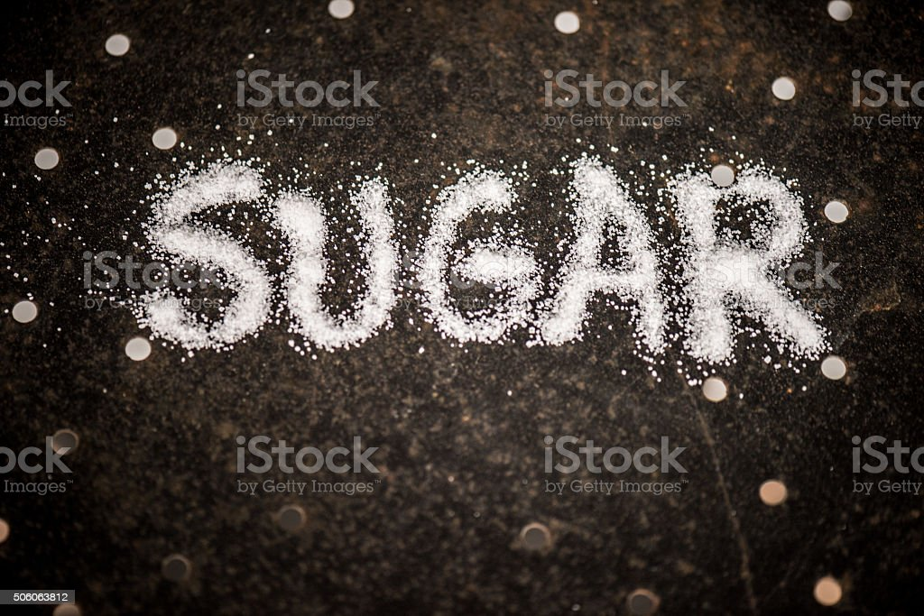 Sugar written in sugar stock photo