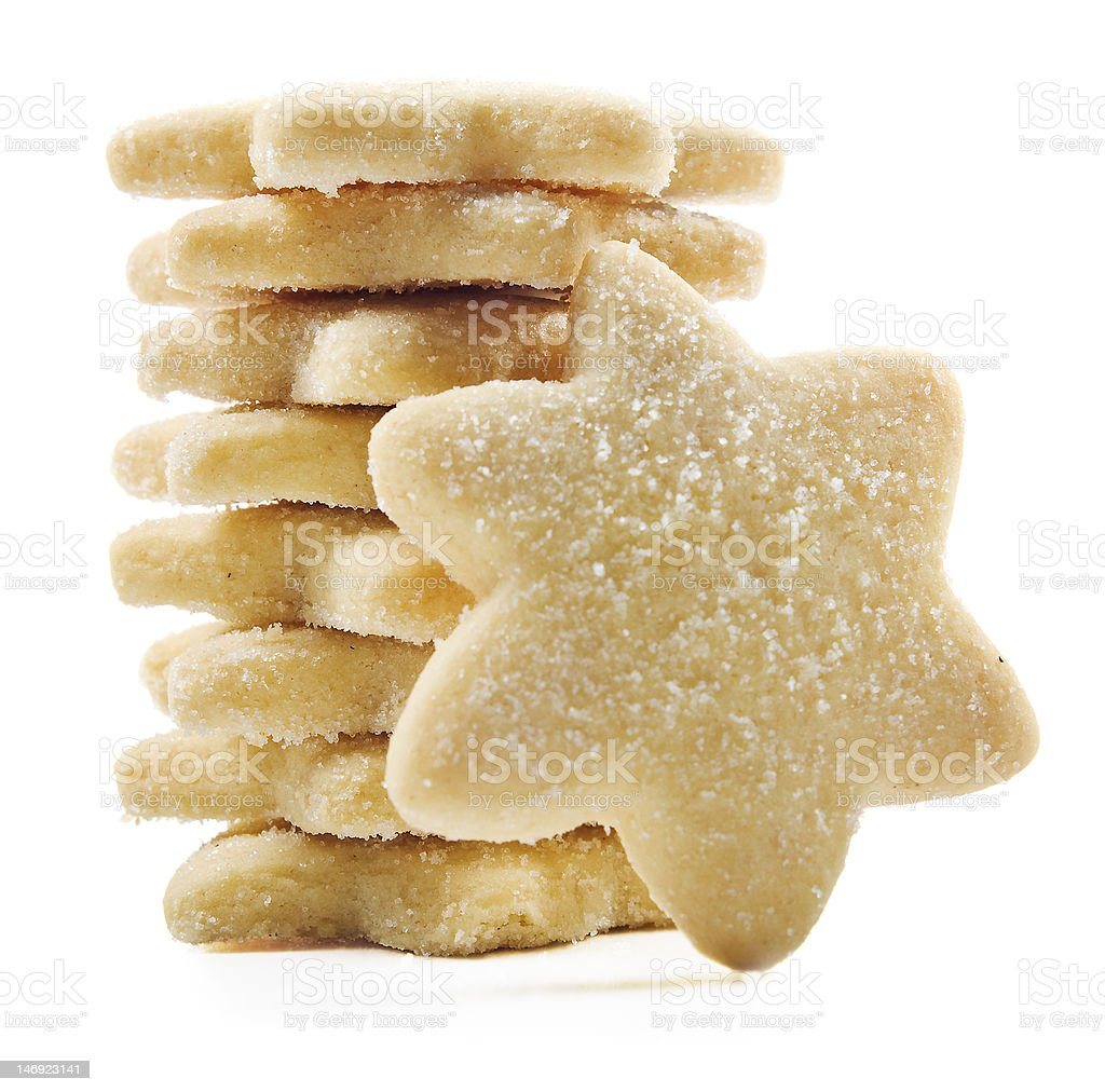 Suger coated shortbread cookies in star shapes stacked up stock photo