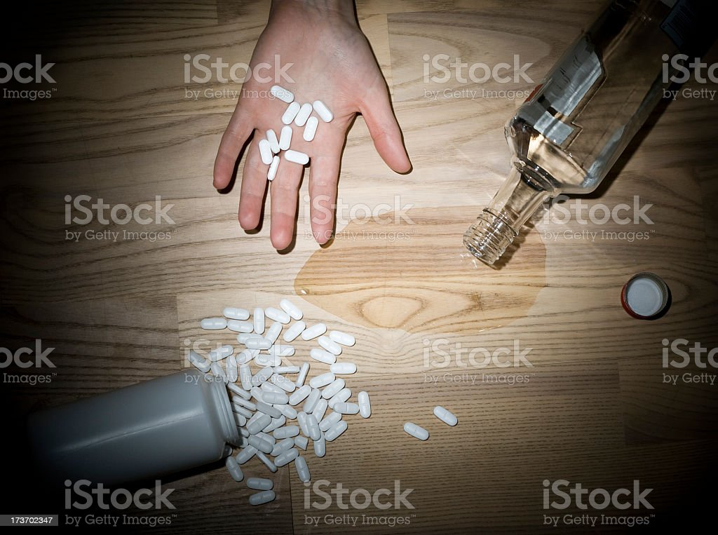 Suicide attempt with pills and alcohol. royalty-free stock photo