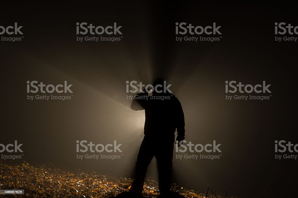 suicide people in the dark forest, gun in hand. stock photo
