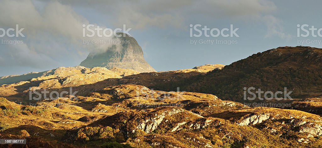 Suilven Mountain lit by Sunset stock photo