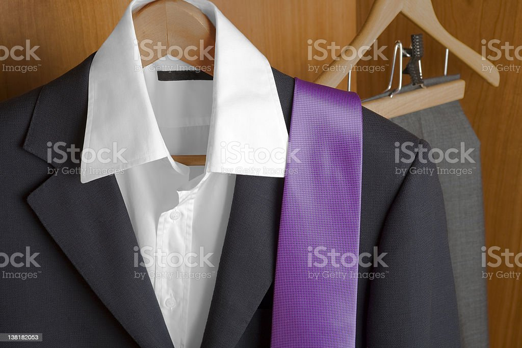 Suit and tie inside of a closet royalty-free stock photo