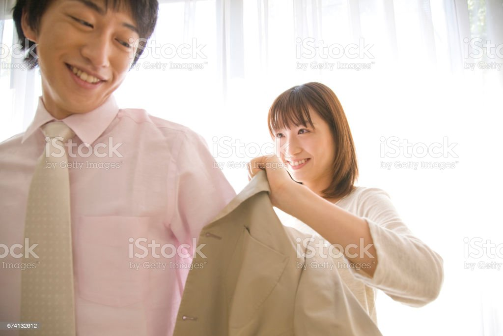 Suit jacket over dress her husband to wife stock photo