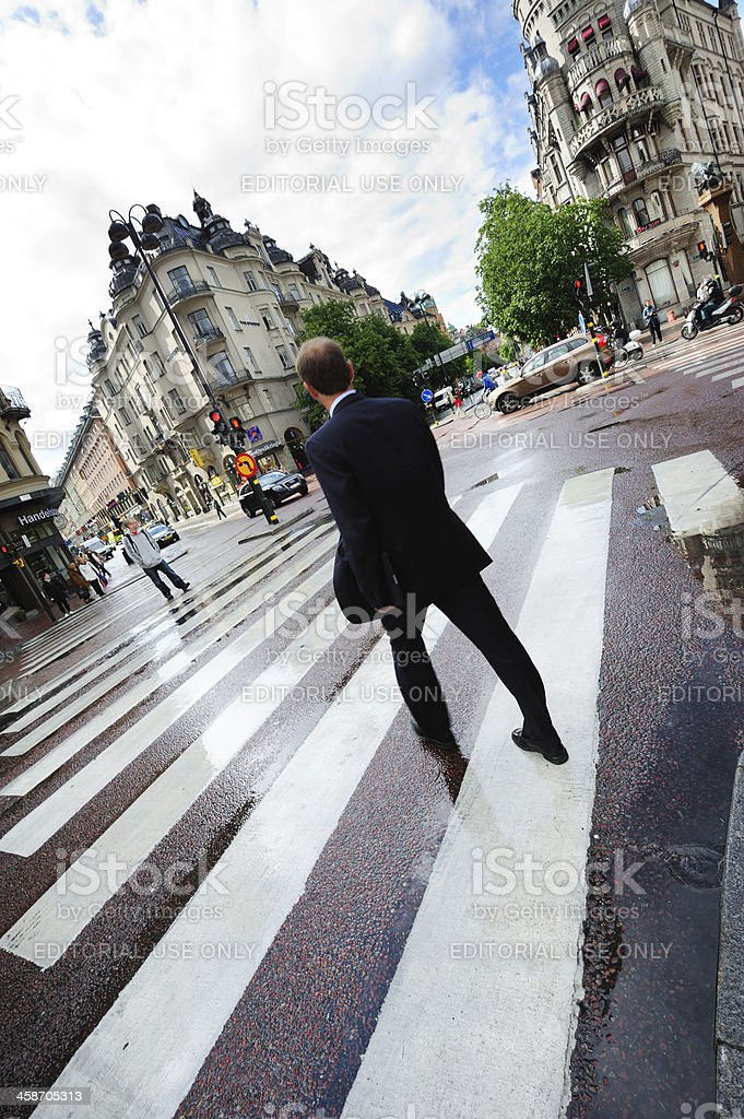 Suit on zebra crossing royalty-free stock photo