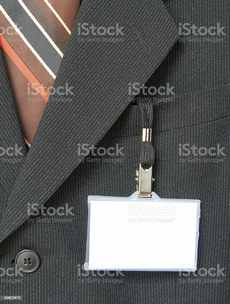 A suit with a plain conference badge royalty-free stock photo