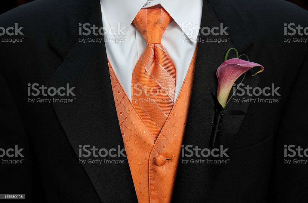 Suit with orange tie and vest royalty-free stock photo