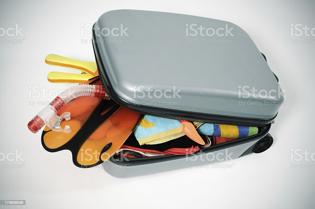 Suitcase fills without being able to be closed royalty-free stock photo