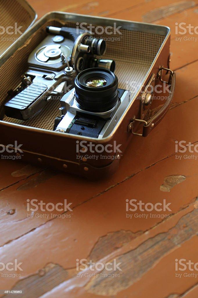 suitcase on the floor, retro style,Camera - Photographic Equipment, stock photo