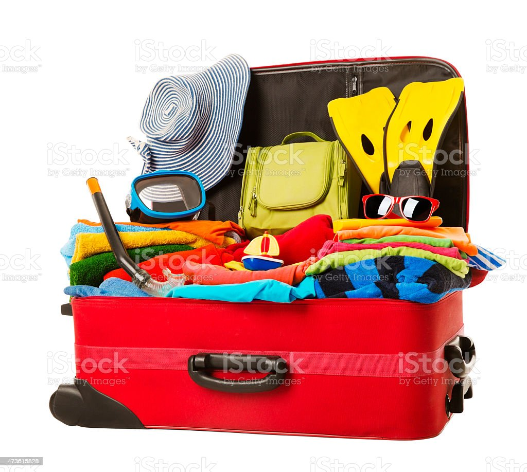 Suitcase Packed Vacation, Open Red Luggage Full Clothes, Family Travel stock photo