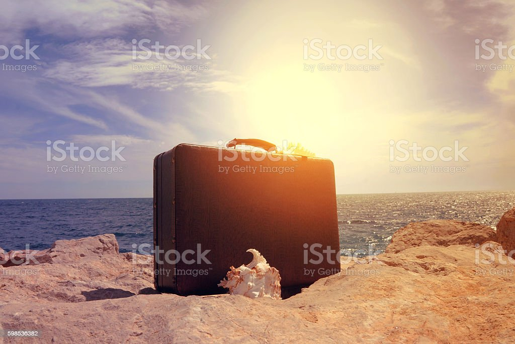 Suitcase, Vacations, Luggage concept travel to sea beach stock photo