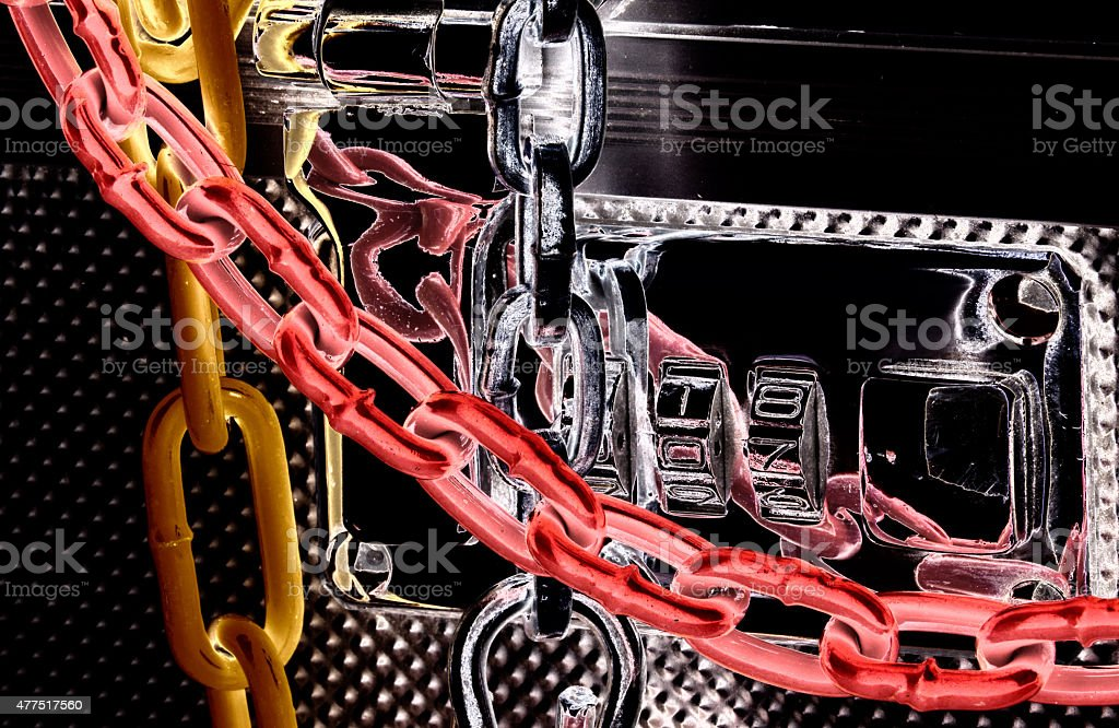 Suitcase with chains around it stock photo