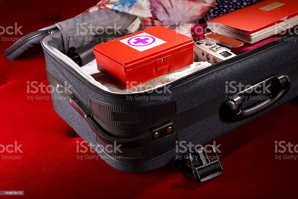 Suitcase with first-aid kit stock photo