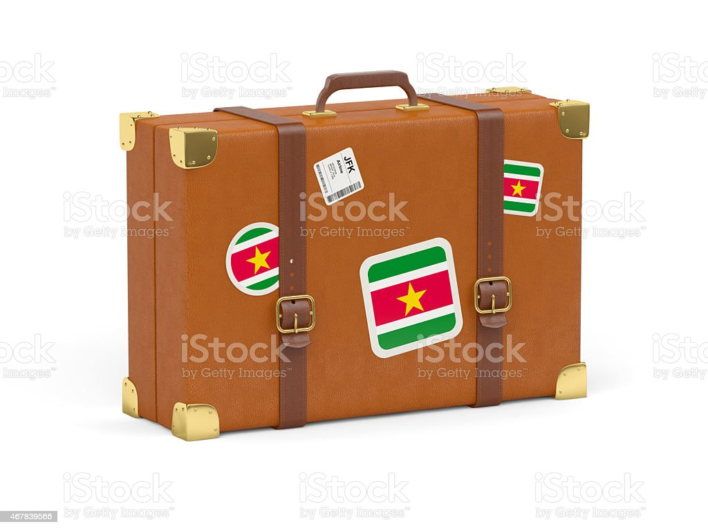 Suitcase with flag of suriname stock photo