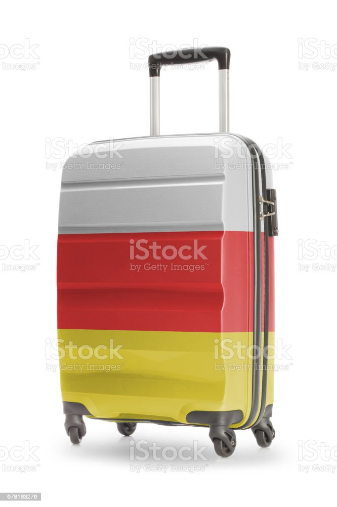 Suitcase with national flag on it - South Ossetia stock photo