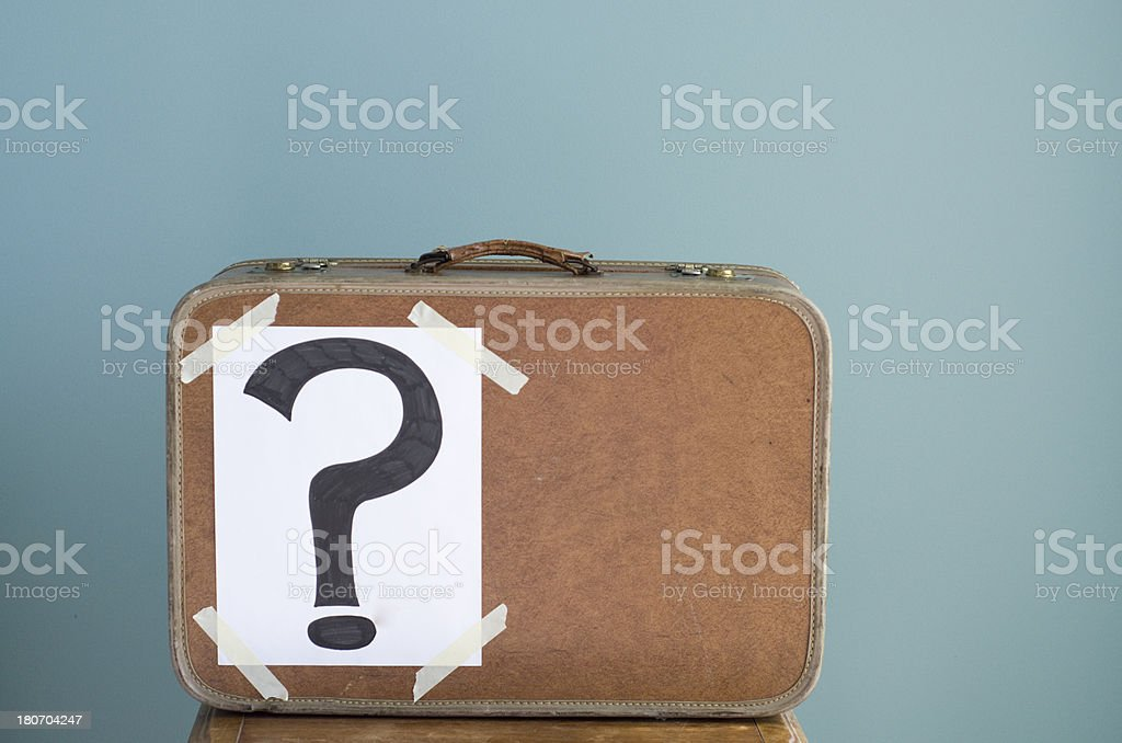 Suitcase with question mark attached royalty-free stock photo