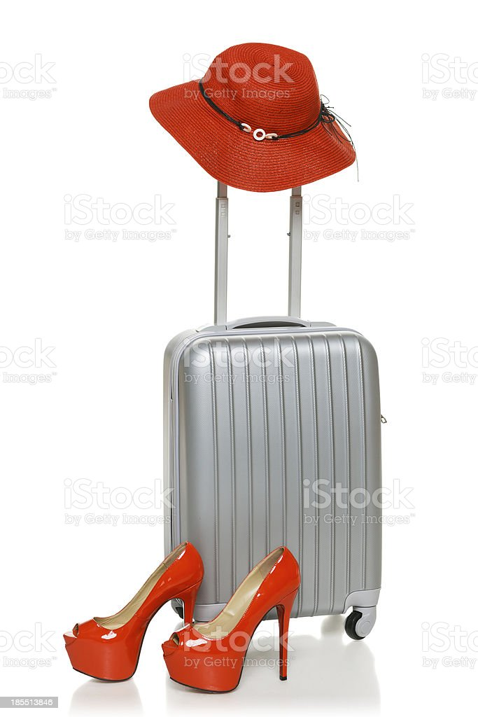 Suitcase with straw hat and shoes royalty-free stock photo