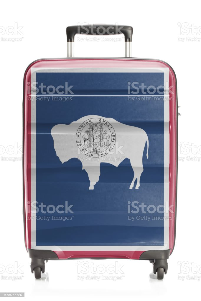 Suitcase with US state flag series - Wyoming stock photo