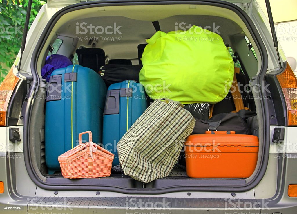 suitcases and many bags in the car stock photo
