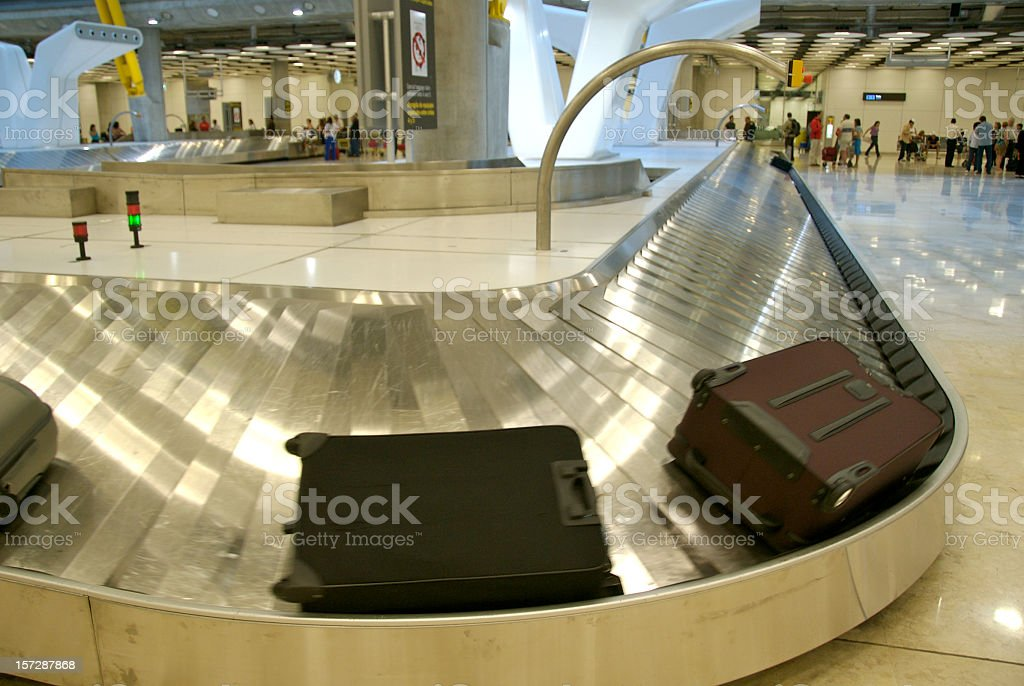 Suitcases on a baggage claim in Madrid, Spain royalty-free stock photo